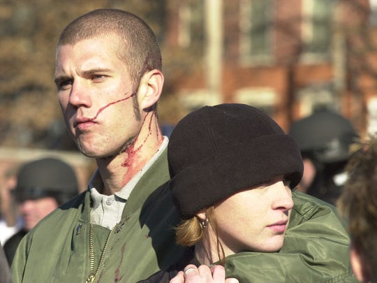 Members of a white supremacy group, one bleeding from a gash on his head, gather in a parking lot at the corner of East King and South Queen streets after clashing with anti-fascists, Jan. 12, 2002. File photos by John Pavoncello