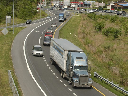 Tractor-trailers make their way south on the Route 13 bypass at Business Route 13 in Salisbury