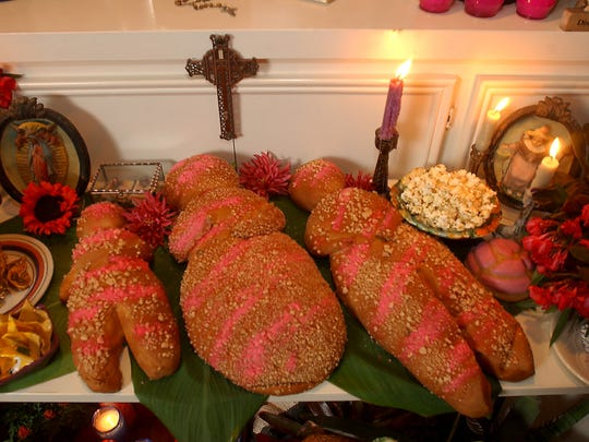 Jackie Gonzalez-Rosier's ofrenda (altar) for Day of the Dead.   The centerpiece is a photo of her daughter, Jessica, who died at age 17.  This is pan de muerto, bread of the dead.  Photo/David Pellerin 10.18.2002
