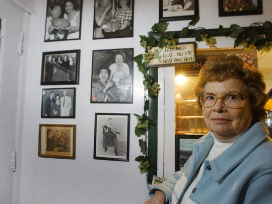 Mary Warble  stands beside a wall at Maria's Pizza , 2930 Shelby Street which she once owned.  The wall contains pictures of well known people.  She longs for the return of one picture which was taken because it showed Ricky Nelson with her daughter Kay Frances Stacey