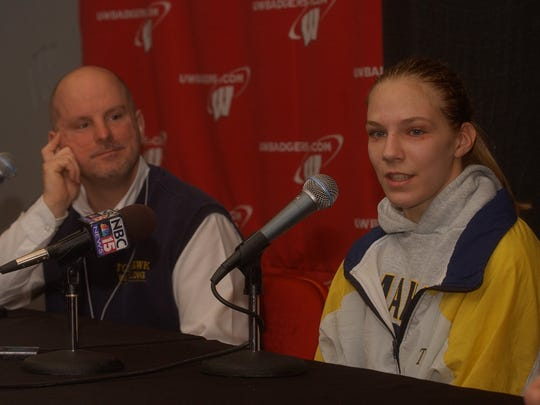 Alyssa Lampe answers questions from the press alongside former Tomahawk Coach Kurt Weyers in 2004 after Lampe became the first girl to compete in the WIAA state wrestling tournament.