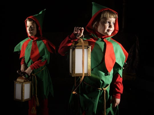 Owen Tuttle, 6, from Luther Jones School and Lilly Stephens, 5, from First Christian Church played the roles of the 'Sprites' in 2014 during The Boar's Head and Yule Log Festival to celebrate the Epiphany season on January 10th and 11th at the First Christian Church.