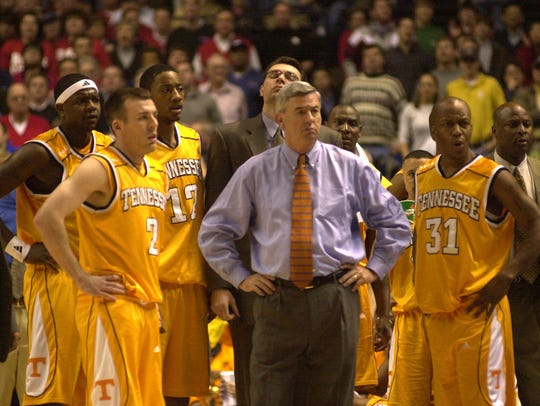 UT Head Coach Jerry Green stands with team players