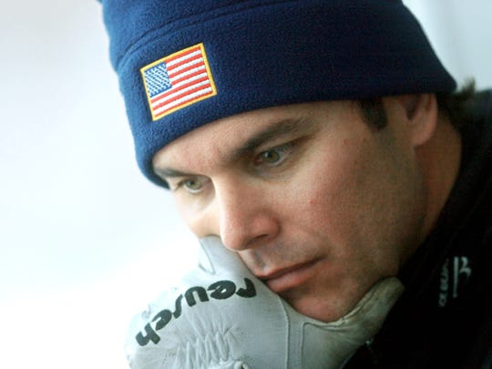 After his first practice run at the 2002 Winter Olympics in Salt Lake City, Naples native and USA Bobsled driver Brian Shimer spends a few moments concentrating before going back down the track.