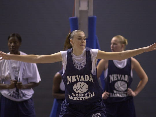 Ashlee Orndorff works during practices with her new