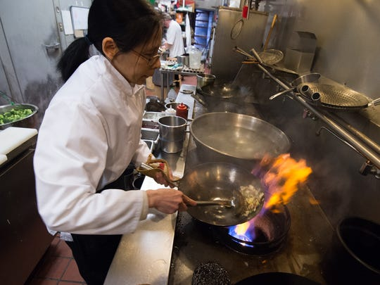 Liai Erion owner of the Golden Rooster Chinese Restaurant in Middletown cooks fried rice in their kitchen.