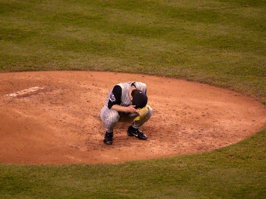 Diamondbacks relief pitcher Byung-Hyun Kim reacts on the mound after giving up a game-tying two-run home run to Scott Brosius of the New York Yankees in the ninth inning of World Series Game 5 at Yankee Stadium Thursday, Nov. 1, 2001.