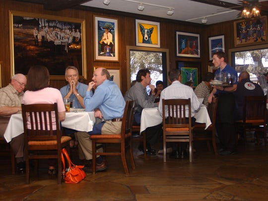 Patrons eat Lunch at the Blue Dog Cafe. The well-known Cajun restaurant has filed for bankruptcy and will restructure with a new menu and chef.