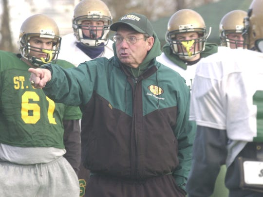 12/02/03: Coach Tony Karcich preparing for championship game at St. Joseph's football practice.