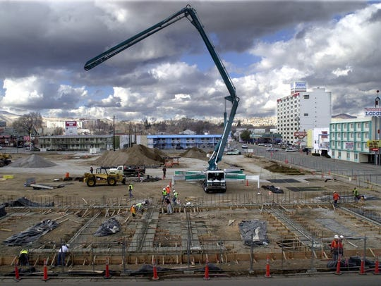 File art of a 58-meter concrete pumping truck folding up for the day in Reno. Higher construction costs are a key concern as the U.S. tariff wars escalate.