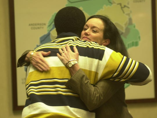 Mintha Roach, who was named acting president and CEO of KUB after the death of president and CEO Larry Fleming in 2003, gets a hug from board member Samuel McKenzie following a meeting at the KUB offices in downtown Knoxville.