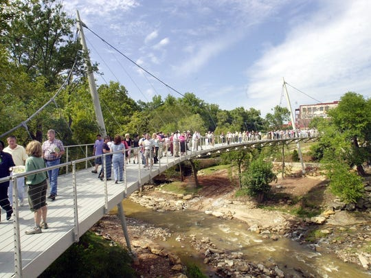 -  -The first visitors to the Reedy Falls Liberty Bridge