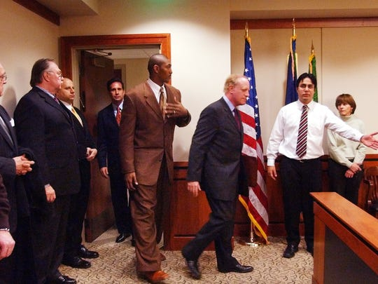 Indiana Pacers' Ron Artest, center, enters 52nd District Judge Lisa Asadoorian's courtroom in Rochester Hills, Mich., Jan. 25, 2005. Five Pacers players charged with misdemeanor assault and battery in the brawl with Detroit fans at The Palace of Auburn Hills appeared in court Tuesday and were released on $500 personal bonds. Each of the Pacers players appeared separately for about three minutes before the judge, who met extensively with each of their lawyers before the hearing.  (AP Photo/Carlos Osorio)