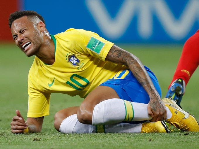 Brazil's Neymar holds his shinbone during the quarterfinal