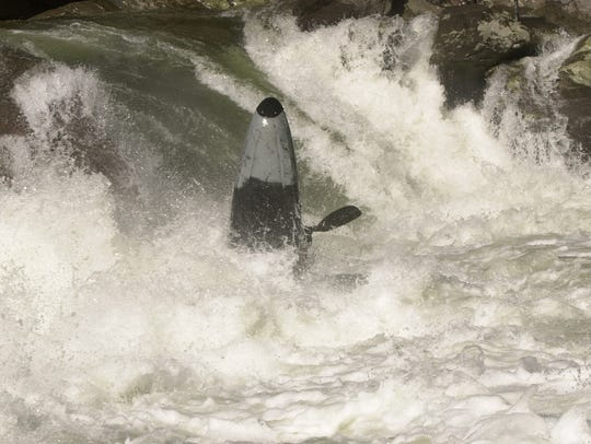 Kayaker Justin Cullars from Knoxville is tossed about