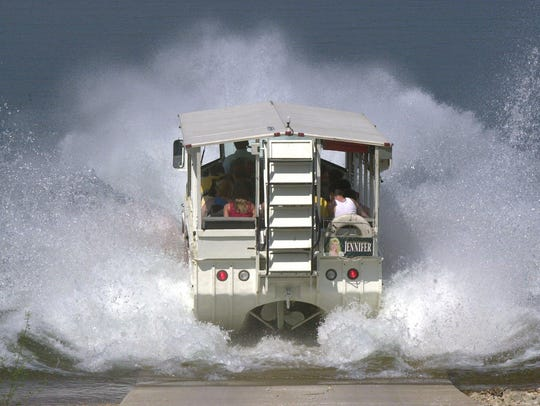An amphibious tour bus splashes into Table Rock Lake
