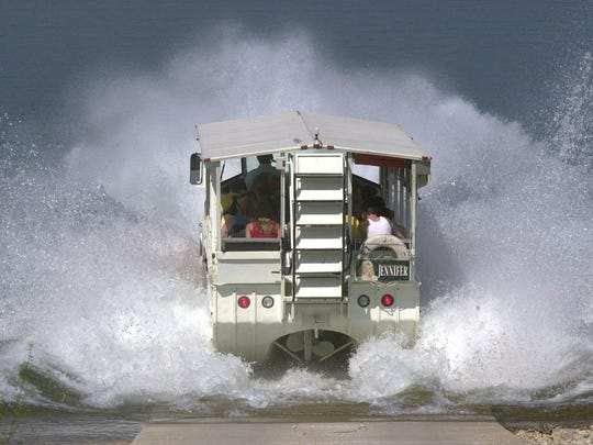 An amphibious tour bus splashes into Table Rock Lake during a Ride The Duck tour Wednesday 5/24/00.