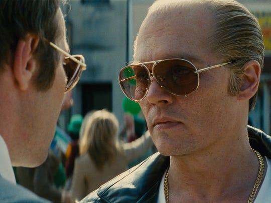 Joel Edgerton (left) and Johnny Depp in the crime drama