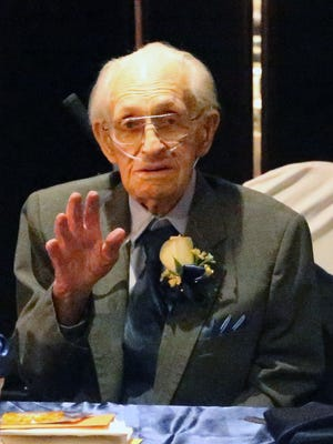 Former El Paso Mayor Ralph E. Seitsinger waves at his 100th birthday celebration earlier this year. Seitsinger died on Wednesday, March 30, 2016.