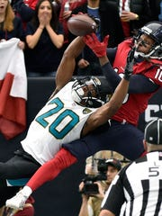Jacksonville Jaguars cornerback Jalen Ramsey (20) breaks up a pass in the end zone intended for Houston Texans' DeAndre Hopkins during the first half of an NFL football game Sunday, Dec. 18, 2016, in Houston.