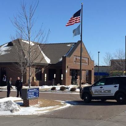 Police respond to a robbery at Dacotah Bank, 3302 E. 10th St., on Thursday.