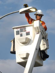 Loren Johnson tests a new LED street light system after