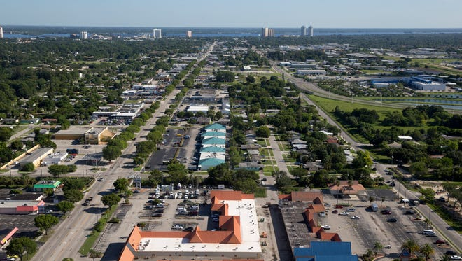 An aerial view looking north of the crime scene at Club Blu (bottom right) in Fort Myers, Fla. Monday, July 25, 2016. Two people were killed and as many as 16 injured after a person opened fire outside of the club just after midnight early Monday morning.