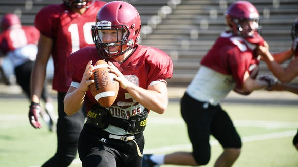 Asheville's new quarterback, Three Hillier, runs a