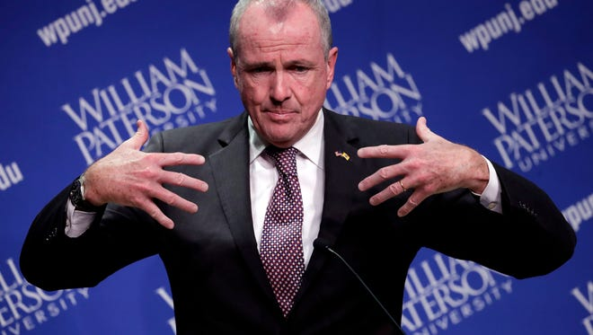 Democratic nominee Phil Murphy talks to reporters after participating in a gubernatorial debate against Republican nominee Lt. Gov. Kim Guadagno at William Paterson University, Wednesday, Oct. 18, 2017, in Wayne.