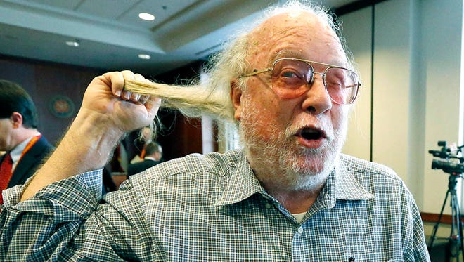 Thomas Blanton, a Hattiesburg businessman who challenged a coal-fired power plant being built by Mississippi Power Company in Kemper County and is candidate for the Public Service Commission, pulls his long pony tail and says he will cut it when he actually has banked his refund check from Mississippi Power Company, Tuesday, July 7, 2015, following the commission meeting in Jackson, Miss. The three commissioners voted to 3-0 to comply with a state Supreme Court order that found illegal the 2013 rate increase for the $6.2 billion plant.
