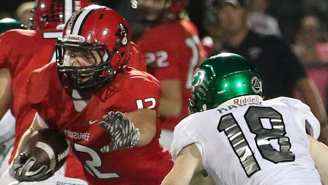 Pewaukee's Seth Bickett pushes for extra yards before being brought down by Greendale's Cal Radka.