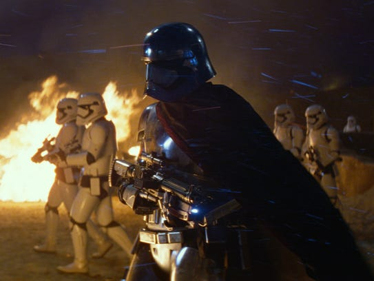 The armored Captain Phasma (Gwendoline Christie) leads