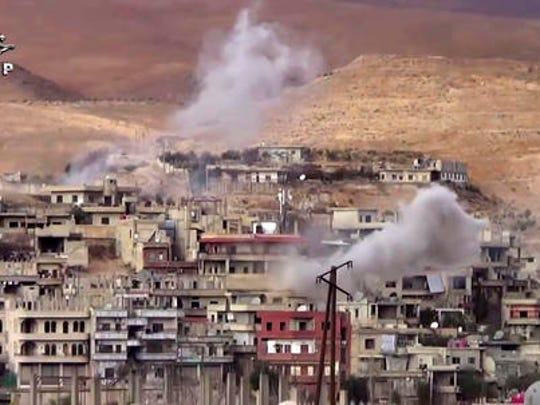 This frame grab from video provided By Step News Agency, a Syrian opposition media outlet that is consistent with independent AP reporting, shows smoke rise from the government forces shelling on Wadi Barada, northwest of Damascus, Syria. Water supplies to Damascus have been largely cut off for nearly two weeks because of fighting between pro-government forces and rebels for control of the main tributary, forcing millions in the Syrian capital to scramble for enough to drink and wash with. The cut-off is a major challenge to the government's effort throughout the nearly 6-year-old civil war to keep the capital as insulated as possible from the effects of the conflict tearing apart much of the country.