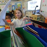 West Salisbury Elementary School kindergarten students Naseer Saunders, left, watches Kassidy Johnson get a book to read during small group time in Erin Johnson class. Under the proposed 5 year plan, West Salisbury would be turned into a pre-k to 5th grade.