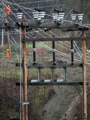 Workers repair power lines in this file photo from Highgate.