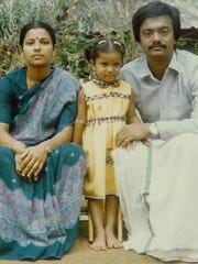 A young Poornima Parameswaran and her parents in India