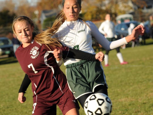 Proctor's Abby McKearin (7) and MSJ's Megan Eaton (8)