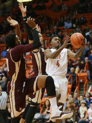 UTEP's Lee Moore puts up a shot against Texas State defenders, including Emani Gant, left, during the first half Saturday.