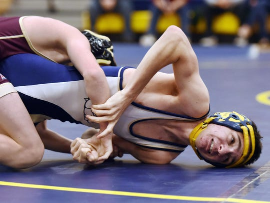 Beacon High School's Liam Ollive, right, wrestles at
