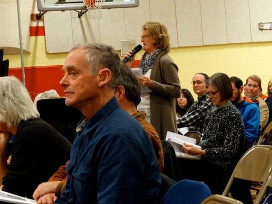 Charlotte resident Frances Foster, center, proposes