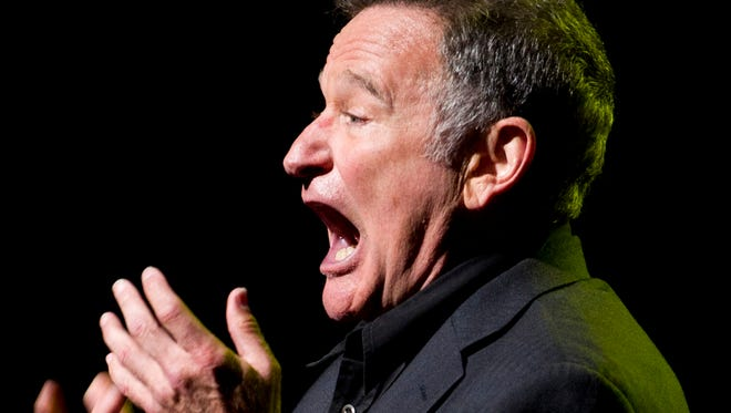 This Nov. 8, 2012 photo shows Robin Williams performing at the 6th Annual Stand Up For Heroes benefit concert for injured service members and veterans in New York. Williams, whose free-form comedy and adept impressions dazzled audiences for decades, has died in an apparent suicide. He was 63.
