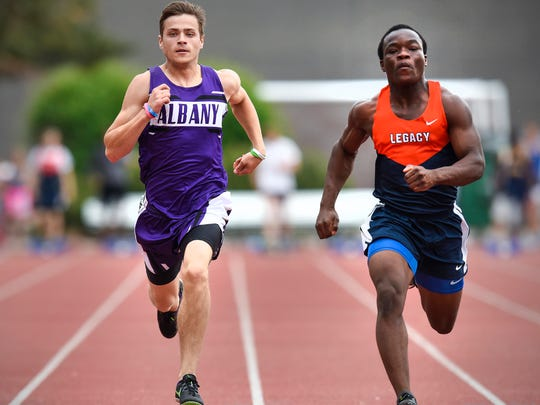 Albany's Peyton Dingmann races Legacy Christian Academy's Caleb Pratt to the finish line during the prelims of the 100-meter dash in the Section 5A track and field championsips Wednesday, May 30, at St. John's University in Collegeville.
