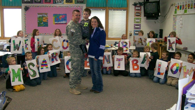 Jacquelyn Guldan's second-grade class at Nasonville School had a very special welcome home surprise on Jan. 23. Master Sergeant Barlow returned from active duty to surprise his son, Brett, in class. Students thought they were only face timing when all of a sudden he appeared in the classroom doorway for real. Thank you for your service Master Sergeant Barlow and enjoy your well deserved time at home. Standing are Barlow with this son Brett and wife Trista Barlow.