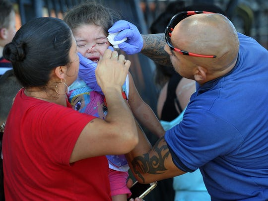 A paramedic tends to one of several small children