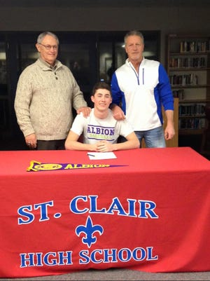 Brendan Marino poses with St. Clair coaches Denny White (left) and Bill McElreath during his Letter of Intent ceremony.