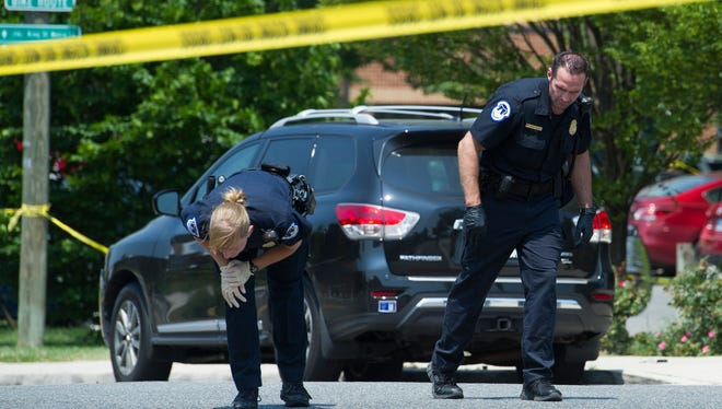 Crime-scene investigators search for evidence at the sight of a multiple shooting in Alexandria, Va., on  June 14, 2017, involving  House Majority Whip Steve Scalise and others during a congressional baseball practice.