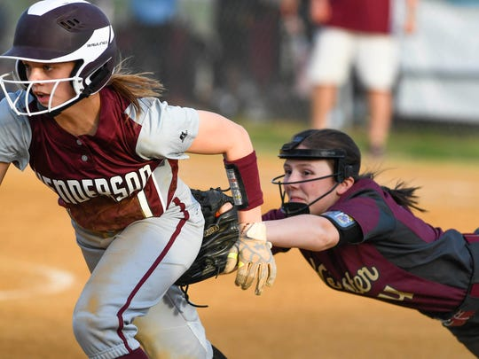 Webster County's Kerstin Braden misses the tag on Henderson's
