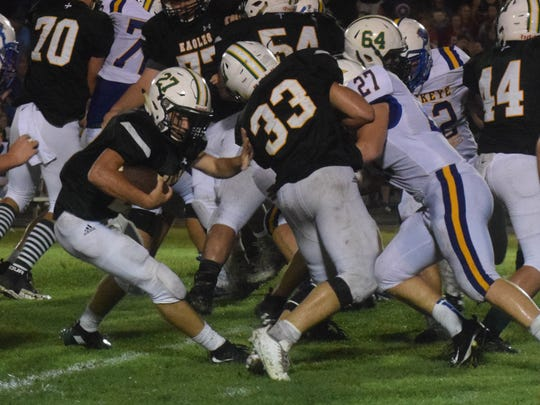 Menard running back Will Thomson (27) tries to find an opening last season against Buckeye.