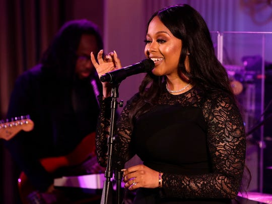 Chrisette Michele, seen here performing at a 2016 White House state dinner, says she didn't meet Donald Trump during the inauguration weekend but did meet with many of his staffers.