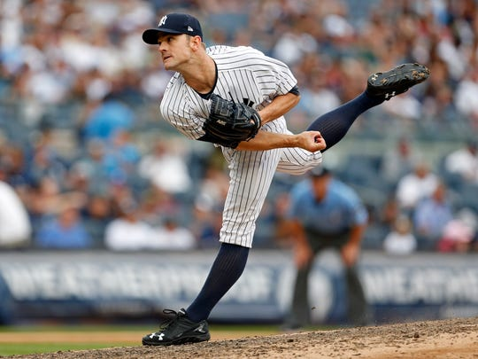 New York Yankees relief pitcher David Robertson (30) pitches against the Tampa Bay Rays during the eighth inning at Yankee Stadium on Saturday, July 29, 2017.